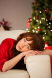 Beautiful redhead relaxing on the couch at christmas Royalty Free Stock Photography