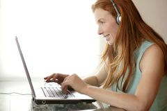 Beautiful redhead secretary student laptop Stock Photography
