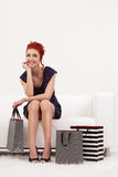 Beautiful redhead with shopping bags royalty free stock images