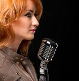 Beautiful redhead singer Royalty Free Stock Photography