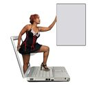 Beautiful Redhead Steps Out of a Laptop Stock Photo