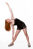 Beautiful redhead stretching Royalty Free Stock Photo