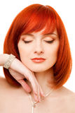 Beautiful redhead woman. With necklace and bracelet stock images
