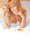Beautiful Redhead Woman In Bed Stock Photo