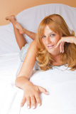 Beautiful Redhead Woman In Bed Stock Images