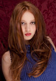 Beautiful Redhead Woman in Blue Stock Photography