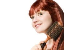 Beautiful redhead woman brushing her hair Royalty Free Stock Photos