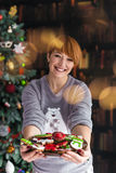 Beautiful Redhead Woman Holding Plate with Cakes Stock Photo