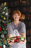 Beautiful Redhead Woman Holding Plate with Cakes Stock Photos