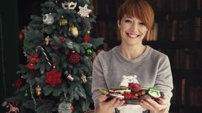 Beautiful Redhead Woman Holding Plate with Cakes stock video footage