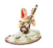 Beautiful Redhead Woman in Indian Sari with Oriental Jewelry Pla Royalty Free Stock Image