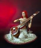 Beautiful Redhead Woman in Indian Sari with Oriental Jewelry Pla Stock Photography