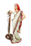 Beautiful Redhead Woman in Indian Sari with Oriental Jewelry Pos Royalty Free Stock Photos