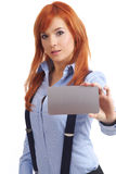 Beautiful redhead woman with notecard. Beautiful redhead businesswoman holding blank credit card Stock Images