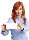 Beautiful redhead woman with notecard. Beautiful redhead businesswoman holding credit card Stock Image