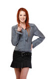 Beautiful redhead woman pointing at you Stock Photo