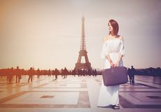 Beautiful redhead woman from province has come to conquer Paris. Eiffel tower on background Stock Image