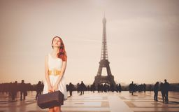 Beautiful redhead woman from province has come to conquer Paris. Eiffel tower on background Royalty Free Stock Images