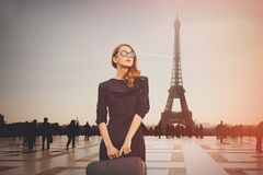 Beautiful redhead woman from province has come to conquer Paris. Eiffel tower on background Royalty Free Stock Image