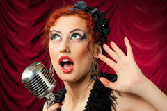 Beautiful redhead woman singing Stock Photography
