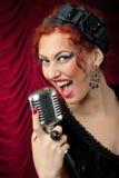 Beautiful redhead woman singing Stock Photos