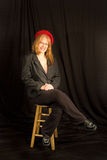 Beautiful Redhead Woman wearing Red Berret. Isolated against a black background stock images