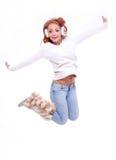 Beautiful redhead woman wearing white earmuffs Stock Photos