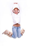 Beautiful redhead woman wearing white earmuffs Stock Photo
