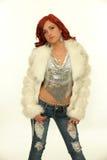Beautiful redhead woman in white fur coat Stock Photo