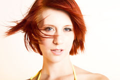 Beautiful redhead woman in the wind Royalty Free Stock Photo