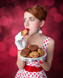 Beautiful redhead women with coockie Royalty Free Stock Photo