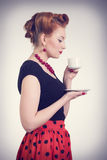Beautiful redhead women with cup of tea. Beautiful redhead woman with cup of tea. Photo in retro style Stock Photography