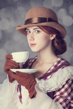 Beautiful redhead women with cup of tea. Royalty Free Stock Images