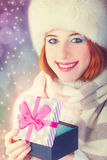 Beautiful redhead women with gift. Stock Photo