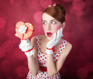 Beautiful redhead women with gift. Stock Photography