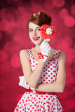 Beautiful redhead women with gift. Royalty Free Stock Photos