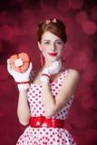 Beautiful redhead women with gift. Stock Image