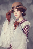 Beautiful redhead women with magnifying glass. Royalty Free Stock Photos