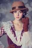 Beautiful redhead women with magnifying glass. Stock Photography