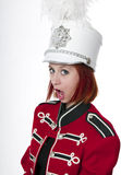 Beautiful redhead young woman in marching band. Redheaded young woman in marching red and white band wardrobe stock photos