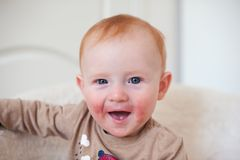 Beautiful redheaded child. With atopic dermatitis Royalty Free Stock Photography