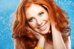 Beautiful redheaded girl. Portrait of beautiful redheaded girl on bue textured background royalty free stock photos