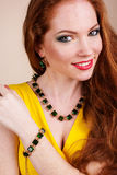 Beautiful redheaded girl with fashion jewelry. Portrait of beautiful redheaded girl with fashion green jewelry Stock Photography
