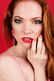 Beautiful redheaded girl with fashion makeup. Closeup portrait of beautiful redheaded girl with fashion colorful makeup Royalty Free Stock Photo