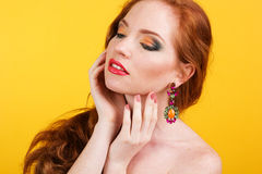Beautiful redheaded girl with fashion makeup. Portrait of beautiful redheaded girl with fashion colorful makeup Royalty Free Stock Photos