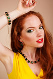 Beautiful redheaded girl with green jewelry. Portrait of beautiful redheaded girl with fashion green jewelry Royalty Free Stock Photos