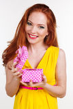 Beautiful redheaded girl is holding gift box Stock Photo