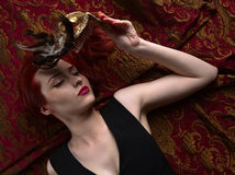 Beautiful redheaded woman with carnival mask Royalty Free Stock Image