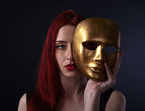 Beautiful redheaded woman with carnival mask Stock Images