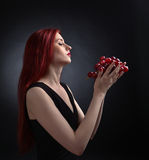 Beautiful redheaded woman with grape Stock Photography